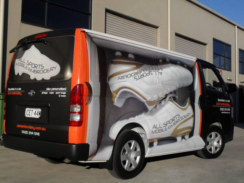 Full van wrap combination matt black vinyl and digital printed graphics to create a moving shoe